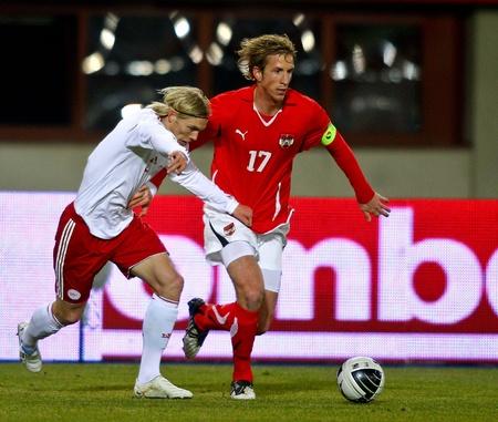 marc: VIENNA,  AUSTRIA - MARCH 3 Austria beats in Denmark 2:1 in a friendly match on March 3, 2010  in Vienna, Austria. Shown are defender Leon Jessen (#5, Denmark) and striker Marc Janko (#17, Austria).