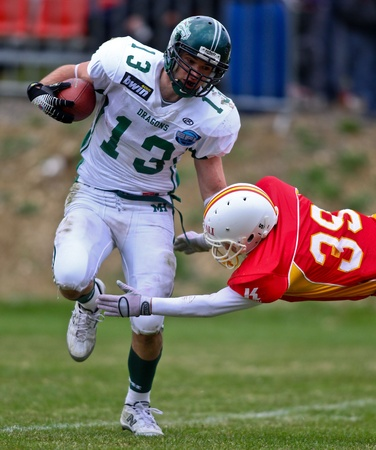 invaders: KORNEUBURG, AUSTRIA - APRIL 10 Danube Dragons beat St. Poelten Invaders in an AFL-season game 63-55 on April 10, 2010. Shown is WR Thomas Haider (Dragons #13).