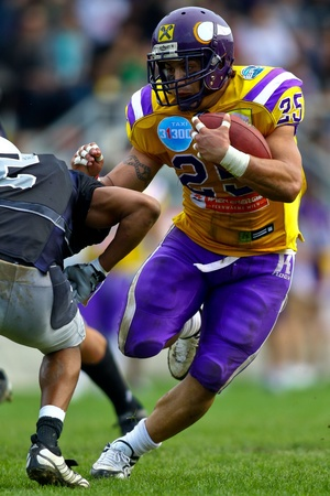 VIENNA, AUSTRIA - MAY 2 Vienna Vikings beat  Badalona Dracs in an EFL-season game 24-0 on May 2, 2010. Shown is RB Josiah Cravalho (Vikings #25). Stock Photo - 8465199