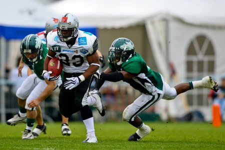 KORNEUBURG, AUSTRIA - MAY 8 Danube Dragons beat  Tirol Raiders in an AFL-season game 33-28 on May 8, 2010. Shown is RB Tory Cooper (Raiders #23). Stock Photo - 8465212