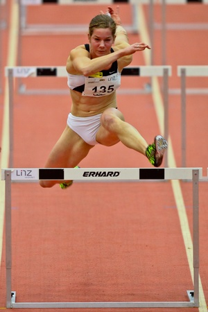 LINZ,  AUSTRIA - FEBRUARY 3 Linz indoor track and field meeting.  Beate Schrott (#135, Austria) places seventh in the womens 60m hurdles event on February 3, 2011 in Linz, Austria.