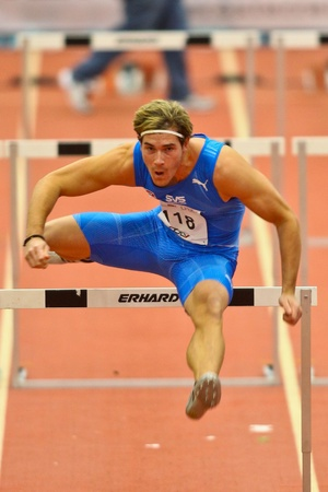 LINZ,  AUSTRIA - FEBRUARY 3 Linz indoor track and field meeting.  Manuel Prazak (#118, Austria) places seventh in the men's 60m hurdles event on February 3, 2011 in Linz, Austria. Stock Photo - 8724277