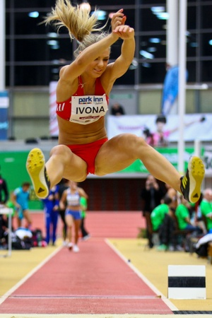 LINZ,  AUSTRIA - FEBRUARY 3 Linz indoor track and field meeting.  Ivona Dadic (#702, Austria) places sixth in the women's long jump event on February 3, 2011 in Linz, Austria. Stock Photo - 8724281