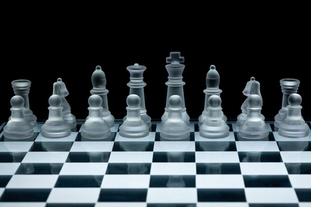 Macro shot of glass chess set against a black background Stock Photo