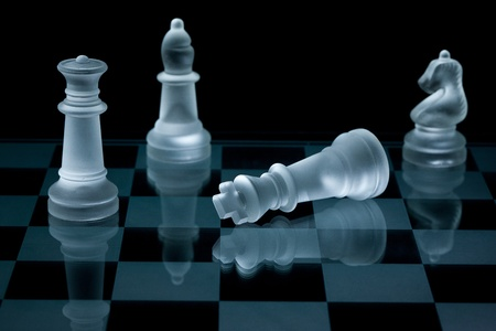 Mate: Macro shot of glass chess pieces against a black background Stock Photo