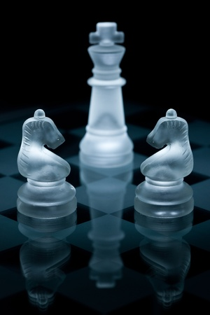 Macro shot of glass chess pieces against a black background Stock Photo