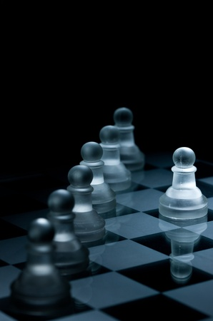 Macro shot of glass chess pieces against a black background photo