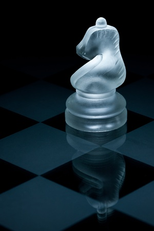 figur: Macro shot of glass chess knight against a black background Stock Photo