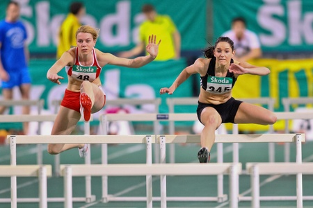VIENNA, AUSTRIA - FEBRUARY 19: Indoor track and field championship. Stephanie Bendrat (#345, Austria)  places third in the womens 60m hurdles event on February 19, 2011 in Vienna, Austria.
