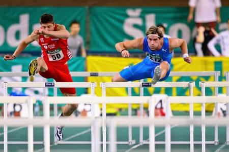 VIENNA, AUSTRIA - FEBRUARY 19: Indoor track and field championship. Manuel Prazak (#212, Austria) wins the men's 60m hurdles event on February 19, 2011 in Vienna, Austria. Stock Photo - 8844315