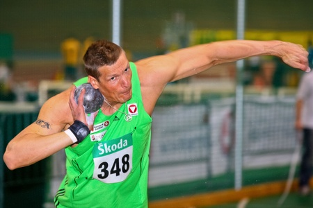 VIENNA, AUSTRIA - FEBRUARY 19: Indoor track and field championship. Roland Schwarzl (#348, Austria) places eighth in the mens shot put event on February 19, 2011 in Vienna, Austria.