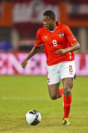 VIENNA,  AUSTRIA - MARCH 25 Austria loses to Belgium 0:2 in a qualifying match for EURO 2012 on March 25, 2011  in Vienna, Austria. Shown is David Alaba (#8, Austria). Stock Photo - 9158260