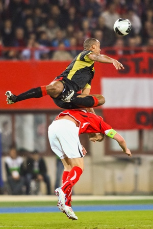 VIENNA,  AUSTRIA - MARCH 25 Austria loses to Belgium 0:2 in a qualifying match for EURO 2012 on March 25, 2011  in Vienna, Austria. Shown are Vincent Kompany (#4, Belgium) and Marc Janko (#21, Austria). Stock Photo - 9158256