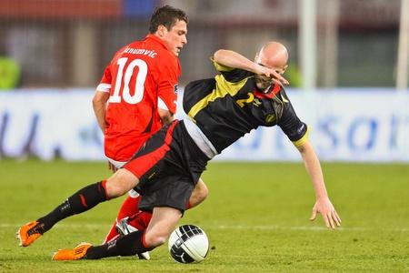VIENNA,  AUSTRIA - MARCH 25 Austria loses to Belgium 0:2 in a qualifying match for EURO 2012 on March 25, 2011  in Vienna, Austria. Shown are Zlatko Junuzovic (10, Austria) and Laurent Ciman (#2, Belgium).