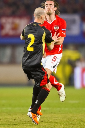 VIENNA,  AUSTRIA - MARCH 25 Austria loses to Belgium 0:2 in a qualifying match for EURO 2012 on March 25, 2011  in Vienna, Austria. Shown are Laurent Ciman (#2, Belgium) and Christian Fuchs (#5, Austria). Stock Photo - 9158258