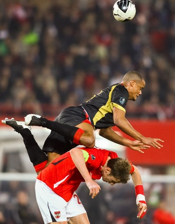 VIENNA,  AUSTRIA - MARCH 25 Austria loses to Belgium 0:2 in a qualifying match for EURO 2012 on March 25, 2011  in Vienna, Austria. Shown are Vincent Kompany (#4, Belgium) and Marc Janko (#21, Austria). Stock Photo - 9158269