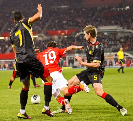 VIENNA,  AUSTRIA - MARCH 25 Austria loses to Belgium 0:2 in a qualifying match for EURO 2012 on March 25, 2011  in Vienna, Austria. Shown are Jan Vertonghen (#5, Belgium) and Martin Harnik (#19, Austria). Editorial
