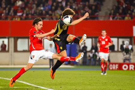 VIENNA,  AUSTRIA - MARCH 25 Austria loses to Belgium 0:2 in a qualifying match for EURO 2012 on March 25, 2011  in Vienna, Austria. Shown are Martin Harnik (#19, Austria) and Axel Witsel (#10, Belgium).