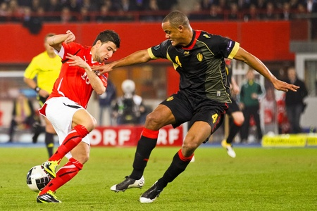 VIENNA,  AUSTRIA - MARCH 25 Austria loses to Belgium 0:2 in a qualifying match for EURO 2012 on March 25, 2011  in Vienna, Austria. Shown are Uemit Korkmaz (#18, Austria) and Vincent Kompany (#4, Belgium).