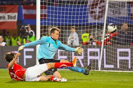 VIENNA,  AUSTRIA - MARCH 25 Austria loses to Belgium 0:2 in a qualifying match for EURO 2012 on March 25, 2011  in Vienna, Austria. Shown are Martin Harnik (#19, Austria) and Simon Mignolet (#1, Belgium). Stock Photo - 9158267