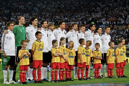 VIENNA,  AUSTRIA - JUNE 3 The german team listens to the national anthem before  the EURO 2012 soccer game on June 3, 2011 in Vienna, Austria. Austria loses 1:2