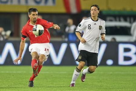 8 12: VIENNA,  AUSTRIA - JUNE 3 Paul Scharner (#16, Austria) and Mesut Oezil (#8, Germany) fight for the ball during the EURO 2012 soccer game on June 3, 2011 in Vienna, Austria. Austria loses 1:2 Editorial