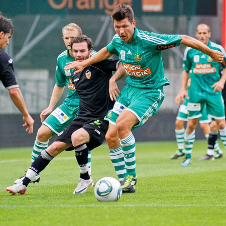 VIENNA,  AUSTRIA - JULY 26 Markus Katzer (#14, Rapid) fights for the ball during the friendly soccer game on July 26, 2011 in Vienna, Austria. SK Rapid wins 4:1. Editorial