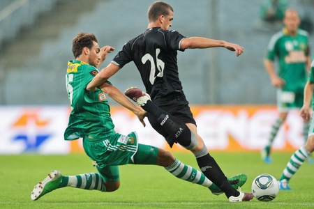 qualify: VIENNA,  AUSTRIA - JULY 26 Atdhe Nuhiu (#15, Rapid)  and Pardo (#26, Valencia) fight for the ball during the friendly soccer game on July 26, 2011 in Vienna, Austria. SK Rapid wins 4:1.