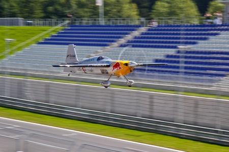 sponsors: ZELTWEG, AUSTRIA - AUGUST 21  Hannes Arch flies a stunt display on August 21, 2011 in Zeltweg, Austria.
