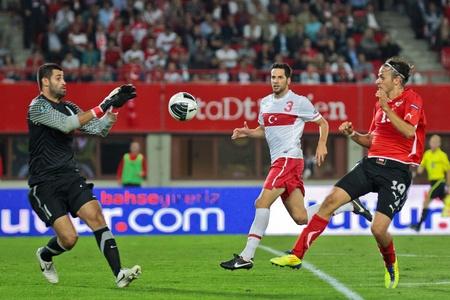 VIENNA,  AUSTRIA - SEPTEMBER 6 Goalkeeper Cetin Servet (#2, Turkey) catches the ball during the EURO 2012 soccer game on September 6, 2011 in Vienna, Austria. The game is a draw.
