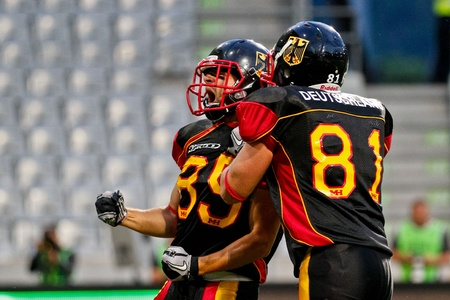 81: INNSBRUCK, AUSTRIA - JULY 8 TE Alexej Mittendorf (#89 Germany) and WR Julian Dohrendorf (#81 Germany) celebrate after a touchdown at the Football World Championship on July 8, 2011 in Innsbruck, Austria. Mexico wins 22:15 against Germany. Editorial