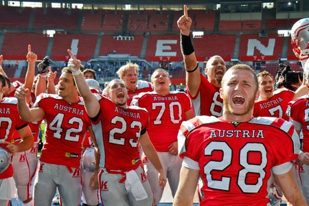 gridiron: VIENNA, AUSTRIA - JULY 15 Team Austria celebrates the victory at the Football World Championship on July 15, 2011 in Vienna, Austria. Austria wins 48:10 against Australia and places seventh in the tournament. Editorial