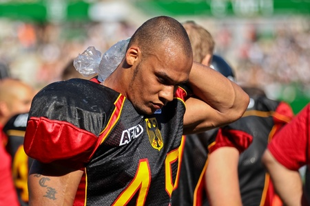 rick: VIENNA, AUSTRIA - JULY 16 LB Rick Baunacke (#45 Germany) cools his head at the Football World Championship on July 16, 2011 in Vienna, Austria. Germany wins 21:17 against France and places fifth in the tournament.