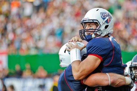 VIENNA, AUSTRIA - JULY 16 QB Cody Hawkins (#7 USA) celebrates after a touchdown at the Football World Championship on July 16, 2011 in Vienna, Austria. USA wins 50:7 against Canada and wins the tournament.