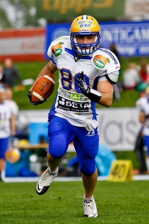 VIENNA, AUSTRIA - APRIL 16 WR Wolfrum Hofbauer (#80 Giants) runs with the ball on April 16, 2011 in Vienna, Austria. The Graz Giants beat the Danube Dragons 20:17.