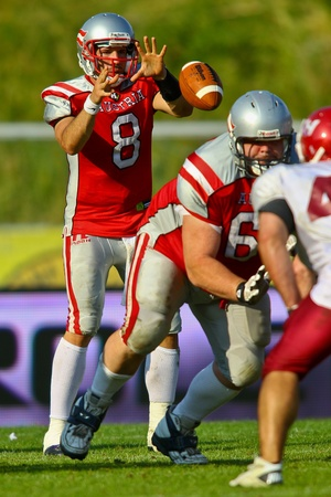 VIENNA, AUSTRIA - JUNE 5 QB Christoph Gross (#8 Austria) during the snap on June 5, 2011 in Vienna, Austria. Rose Hulman College beats Team Austria 35:34 in overtime.