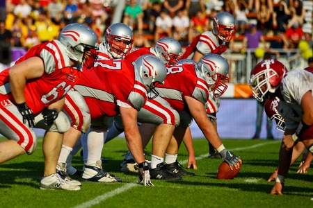 VIENNA, AUSTRIA - JUNE 5 QB Christoph Gross (#8 Austria) at the line of scrimmage on June 5, 2011 in Vienna, Austria. Rose Hulman College beats Team Austria 35:34 in overtime.