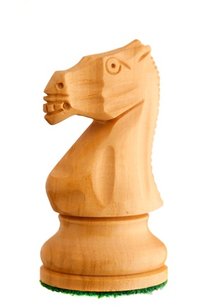 Photo of a single chess piece - a white knight.