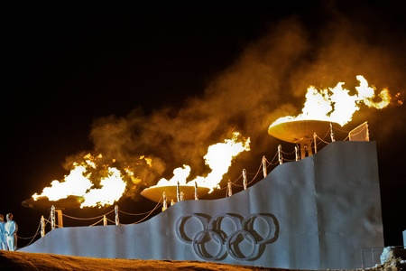 INNSBRUCK, AUSTRIA - JANUARY 13 The olympic fire is burning during the opening ceremony at the Bergisel stadium on January 13, 2012 in Innsbruck, Austria. Editorial