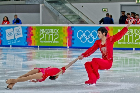 INNSBRUCK, AUSTRIA - JANUARY 14 Xiaoyu Yu and  Yang Jin (China) place first in the figure skating short program for pairs on January 14, 2012 in Innsbruck, Austria.