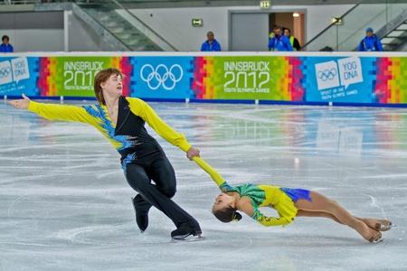 yog: INNSBRUCK, AUSTRIA - JANUARY 14 Lina Fedorova and Maxim Miroshkin (Russia) place second in the figure skating short program for pairs on January 14, 2012 in Innsbruck, Austria.