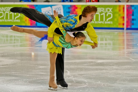 innbruck: INNSBRUCK, AUSTRIA - JANUARY 14 Lina Fedorova and Maxim Miroshkin (Russia) place second in the figure skating short program for pairs on January 14, 2012 in Innsbruck, Austria.