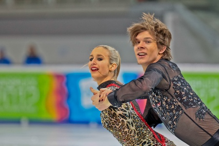 INNSBRUCK, AUSTRIA - JANUARY 15 Anna Yanovskya and Sergey Mozgov (Russia) place first in the short dance competition of the pairs ice dance on January 15, 2012 in Innsbruck, Austria.