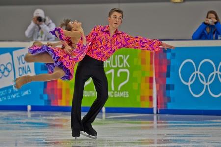 INNSBRUCK, AUSTRIA - JANUARY 15 Eugenia Tkachenka and Yuri Gulitski (Belarus) place 10th in the short dance competition of the pairs ice dance on January 15, 2012 in Innsbruck, Austria. Stock Photo - 12160195