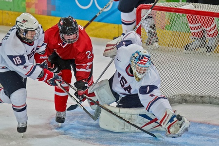 INNSBRUCK, AUSTRIA - JANUARY 15 Edwin Minney (USA) catches the puck a Canada beats the USA 5:1 in the mens ice hockey tournament on January 15, 2012 in Innsbruck, Austria.