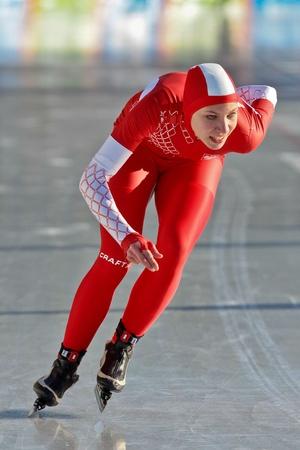 innbruck: INNSBRUCK, AUSTRIA - JANUARY 16 Aleksandra Milena Kapruziak (Poland) places 10th in the ladies 1500 speed skating event on January 16, 2012 in Innsbruck, Austria.