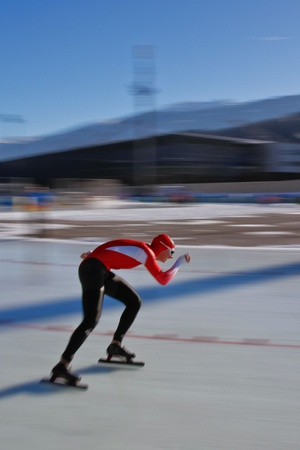 yog: INNSBRUCK, AUSTRIA - JANUARY 16 Manuel Vogel (Austria) places 13th in the mens 1500 speed skating event on January 16, 2012 in Innsbruck, Austria.