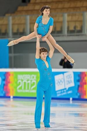 INNSBRUCK, AUSTRIA - JANUARY 16 Ieliyaveta Usmantseva and Vladislav Lysoy (Ukraine) place 5th in the pairs figure skating event on January 16, 2012 in Innsbruck, Austria.