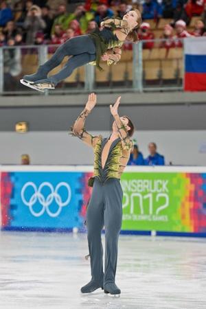 yog: INNSBRUCK, AUSTRIA - JANUARY 16 Anastasia Dolidze and Vadim Ivanov (Russia) place third in the pairs figure skating event on January 16, 2012 in Innsbruck, Austria. Editorial