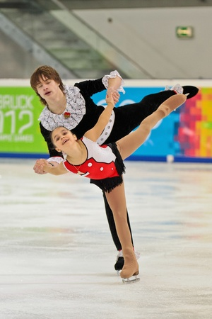 INNSBRUCK, AUSTRIA - JANUARY 16 Lina Fedorova and Maxim Miroshkin (Russia) place 5th in pairs figure skating event on January 16, 2012 in Innsbruck, Austria.